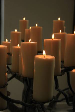 29678481-group-of-burning-candles-at-a-funeral-service